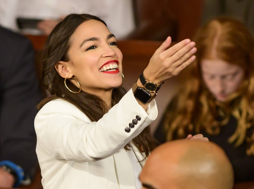 January 3, 2019 - Washington, District of Columbia, U.S. - United States Representative Alexandria Ocasio-Cortez (Democrat of New York) gestures towards someone in the gallery as the 116th Congress convenes for its opening session in the US House Chamber of the US Capitol in Washington, DC on Thursday, January 3, 2019 Washington U.S. PUBLICATIONxINxGERxSUIxAUTxONLY - ZUMAc306 20190103_zaa_c306_002 Copyright: xRonxSachsx