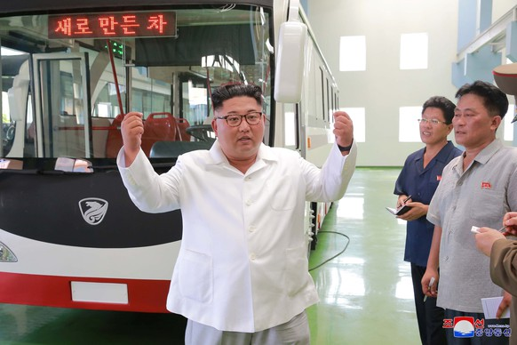 North Korean leader Kim Jong Un visits the Pyongyang Trolley Bus Factory and the Bus Repair Factory in Pyongyang, North Korea in this photo released August 4, 2018 by North Korea's Korean Central News Agency. KCNA/ via REUTERS ATTENTION EDITORS - THIS IMAGE WAS PROVIDED BY A THIRD PARTY. REUTERS IS UNABLE TO INDEPENDENTLY VERIFY THIS IMAGE. NO THIRD PARTY SALES. SOUTH KOREA OUT.