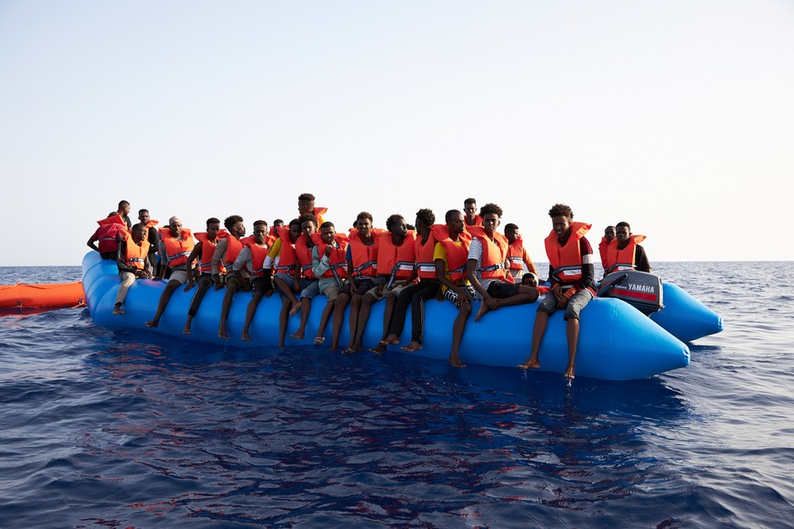 A blue inflatable boat carrying 65 people, about 34 miles from the Libyan coast according to Sea-eye, in this picture obtained from social media on July 5, 2019.  Courtesy of Sea-eye/Social Media via REUTERS   THIS IMAGE HAS BEEN SUPPLIED BY A THIRD PARTY.  MANDATORY CREDIT.  NO RESALES. NO ARCHIVES.