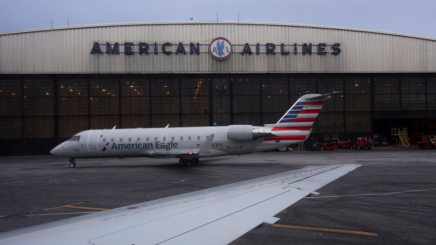 FILE- In this March 12, 2018, file photo, operations proceed outside the American Airlines facility at LaGuardia Airport in New York. American Airlines reports earns on Thursday, April 26. (AP Photo/John Minchillo, File)