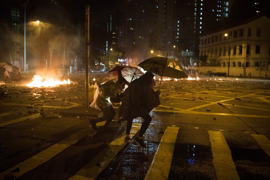 November 18, 2019, Hong Kong, China: Protesters clash with police outside Hong Kong Polytechnic University, where a police officer was shot in the leg with an arrow and an armoured vehicle was set on fire, as protesters continue to defend their makeshift base at the university. Protesters continue to call on Chief Executive Lam to meet their remaining demands, which includes complete universal suffrage, an independent investigation into police brutality, retraction of the word rioting to describe the protests, and dropping all charges against arrested protesters. Hong Kong China PUBLICATIONxINxGERxSUIxAUTxONLY - ZUMAs197 20191118zaas197001 Copyright: xOliverxHaynesx