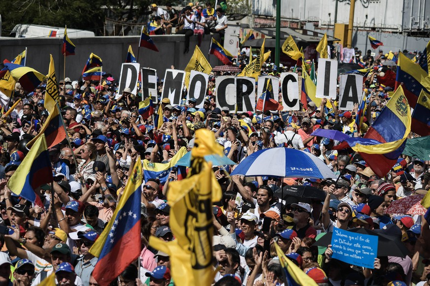 February 2, 2019 - Caracas, Miranda, Venezuela - Large crowd of president Juan Guaido s supporters seen holding several placards during a protest against Maduro. Opposition supporters take part in a rally against Venezuelan President Nicolas Maduro s government in Caracas and to support Venezuelan opposition leader and self-proclaimed interim president Juan Guaido. Caracas Venezuela PUBLICATIONxINxGERxSUIxAUTxONLY - ZUMAs197 20190202_zaa_s197_316 Copyright: xRomanxCamachox