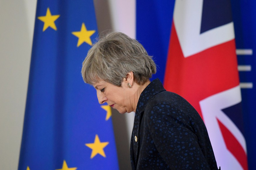 FILE PHOTO: Britain's Prime Minister Theresa May leaves after giving a news briefing in Brussels, Belgium, March 22, 2019.  REUTERS/Toby Melville/File Photo