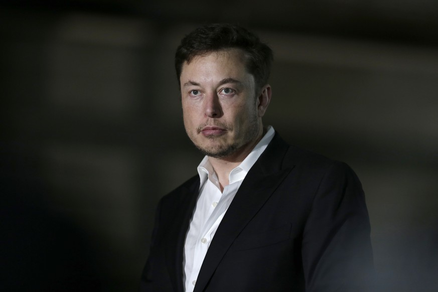 FILE- In this June 14, 2018, file photo, Tesla CEO and founder of the Boring Company Elon Musk speaks at a news conference in Chicago. Tesla is suing a former employee at its Nevada battery factory alleging that he hacked into the manufacturing computers and disclosed confidential trade secrets. The federal lawsuit filed Wednesday, June 20, contends that Martin Tripp of Sparks, Nev., also made false claims to the media about information he stole, including claims that the company used punctured battery cells in the Model 3 electric car. (AP Photo/Kiichiro Sato)
