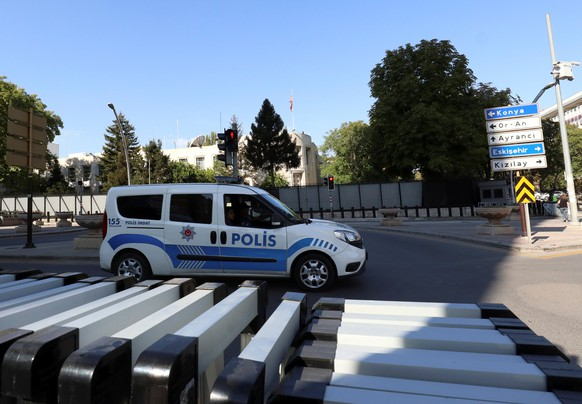 A police car is parked in front of the U.S. Embassy in Ankara, Turkey August 20, 2018. REUTERS/Tumay Berkin