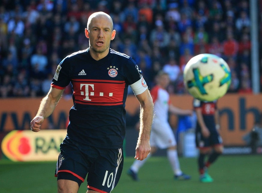 (180408) -- AUGSBURG, April 8, 2018 -- Bayern Munich s Arjen Robben competes during a German Bundesliga match between FC Augsburg and Bayern Munich, in Augsburg, Germany, on April 7, 2018. Bayern Munich won 4-1 to clinch its sixth consecutive Bundeslisga title ahead of schedule at the 29th round on Saturday. ) (SP)GERMANY-AUGSBURG-SOCCER-BUNDESLIGA-FCA VS FCB PhilippexRuiz PUBLICATIONxNOTxINxCHN