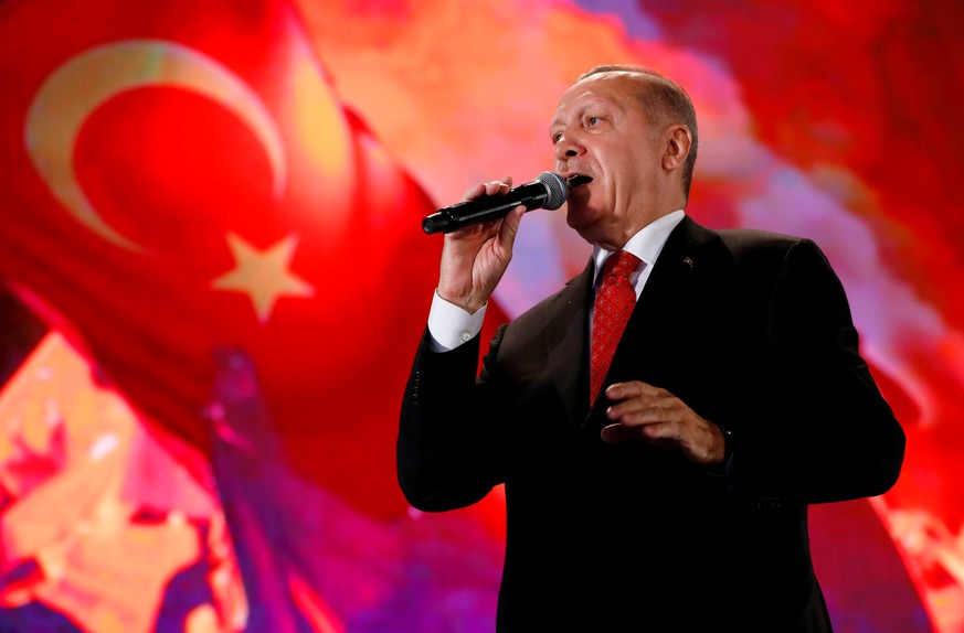 FILE PHOTO: FILE PHOTO: Turkish President Tayyip Erdogan addresses his supporters during a ceremony marking the third anniversary of the attempted coup at Ataturk Airport in Istanbul, Turkey, July 15, 2019. REUTERS/Murad Sezer/File Photo