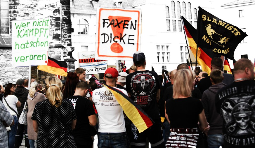 KOETHEN, GERMANY - SEPTEMBER 16: Protesters gather to participate in a march organized by the right-wing AfD political party as well as the right-wing Pegida and