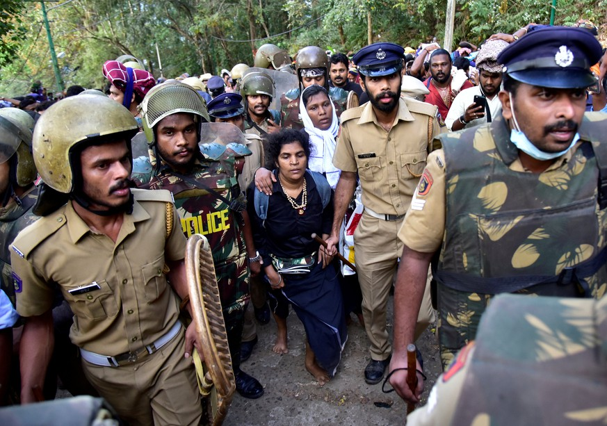 Bindu Ammini, 42, and Kanaka Durga, 44, are escorted by police after they attempted to enter the Sabarimala temple in Pathanamthitta district in the southern state of Kerala, India, December 24, 2018. Picture taken December 24, 2018. REUTERS/Stringer     TPX IMAGES OF THE DAY