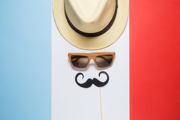 Hipster retro vintage guy abstract against french flag background minimal concept. Hat, sunglasses and mustache paper prop flat lay.