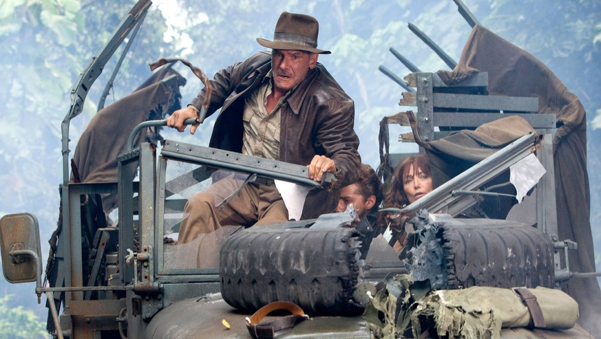 RELEASE DATE: May 22, 2008. MOVIE TITLE: Indiana Jones and the Kingdom of the Crystal Skull. STUDIO: Paramount. PLOT: Famed archaeologist/adventurer Dr. Henry Indiana Jones is called back into action when he becomes entangled in a Soviet plot to uncover the secret behind mysterious artifacts known as the Crystal Skulls. PICTURED: SHIA LABEOUF as Mutt Williams, HARRISON FORD as Indiana Jones and KAREN ALLEN as Marion Ravenwood. PUBLICATIONxINxGERxSUIxAUTxONLY - ZUMAl90_ 20080528_sha_l90_155