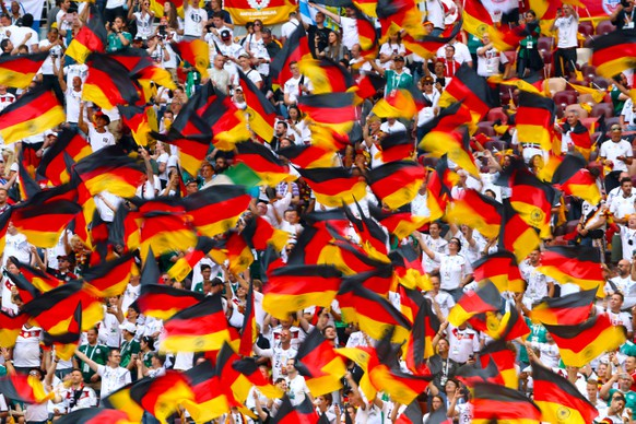 Germany v Mexico - FIFA World Cup WM Weltmeisterschaft Fussball 2018 - Group F - Luzhniki Stadium Germany fans wave flags in the stands ahead of the match Editorial use only. No commercial use. No use with any unofficial 3rd party logos. No manipulation of images. No video emulation PUBLICATIONxINxGERxSUIxAUTxONLY Copyright: xTimxGoodex 37054201