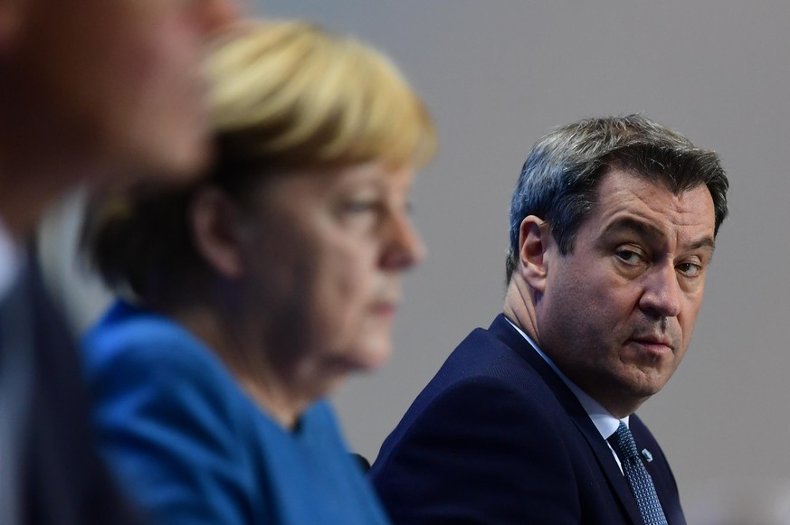 BERLIN, GERMANY - OCTOBER 28: (L-R) German Chancellor Angela Merkel and Premier of Bavaria Markus Soeder attend a press conference after a video conference with German State Premiers about the current coronavirus situation, at the Chancellery on October 28, 2020 in Berlin, Germany. (Photo by Filip Singer - Pool/Getty Images)