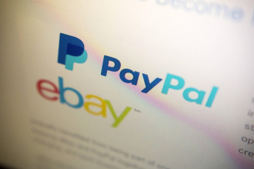 EBay to spin off PayPal An announcement on the EBay home page on Tuesday, September 30, 2014 informs consumers that EBay will spin off its PayPal unit into a separate public company next year. EBay acquired PayPal 12 years ago and it is responsible for almost half of the company s revenues. ( PUBLICATIONxNOTxINxUSAxUK RICHARDxB.xLEVINE