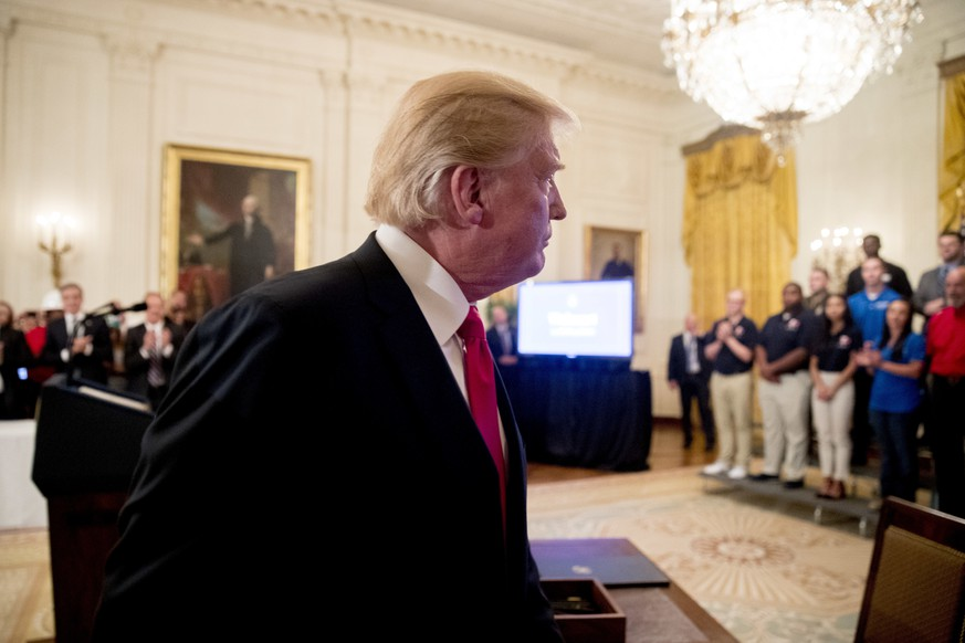 President Donald Trump departs after signing an Executive Order that establishes a National Council for the American Worker during a ceremony in the East Room of the White House, Thursday, July 19, 2018, in Washington. (AP Photo/Andrew Harnik)