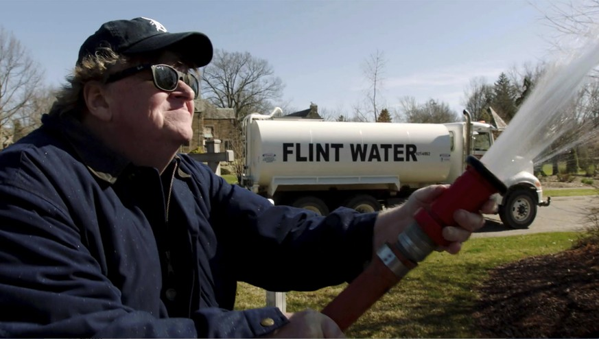 This image released by State Run Films/Briarcliff Entertainment shows filmmaker Michael Moore in a scene from the documentary