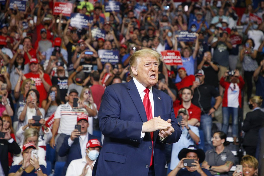 President Donald Trump claps while supporters cheer during his campaign rally at BOK Center in Tulsa, Okla., Saturday, June 20, 2020. (Ian Maule/Tulsa World via AP)