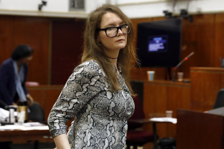 Anna Sorokin leaves during the lunch break at her trial in New York State Supreme Court, in New York, Monday, April 22, 2019. Sorokin, who claimed to be a German heiress, is on trial on grand larceny and theft of services charges. (AP Photo/Richard Drew)