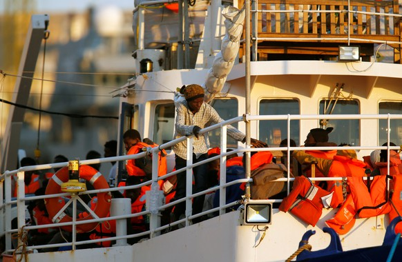 REFILE - CORRECTING LOCATION  Migrants are seen onboard the charity ship Lifeline at Boiler Wharf in Senglea, in Valletta's Grand Harbour, Malta June 27, 2018.  REUTERS/Darrin Zammit Lupi