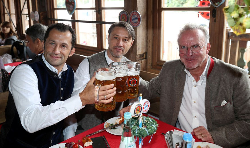 Soccer Football - Bayern Munich players attend Oktoberfest - Munich, Germany - October 6, 2019  Bayern Munich's sporting director Hasan Salihamidzic, head coach Niko Kovac and CEO Karl-Heinz Rummenigge pose for a picture during Oktoberfest  REUTERS/Stefan Matzke/Pool