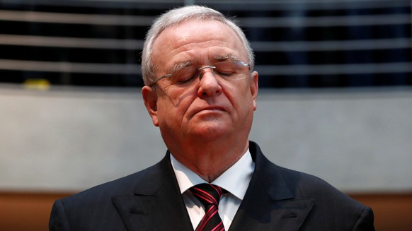 FILE PHOTO: Former Volkswagen chief executive Martin Winterkorn arrives to testify to a German parliamentary committee on the carmaker's emissions scandal in Berlin, Germany, January 19, 2017. REUTERS/Fabrizio Bensch/File Photo