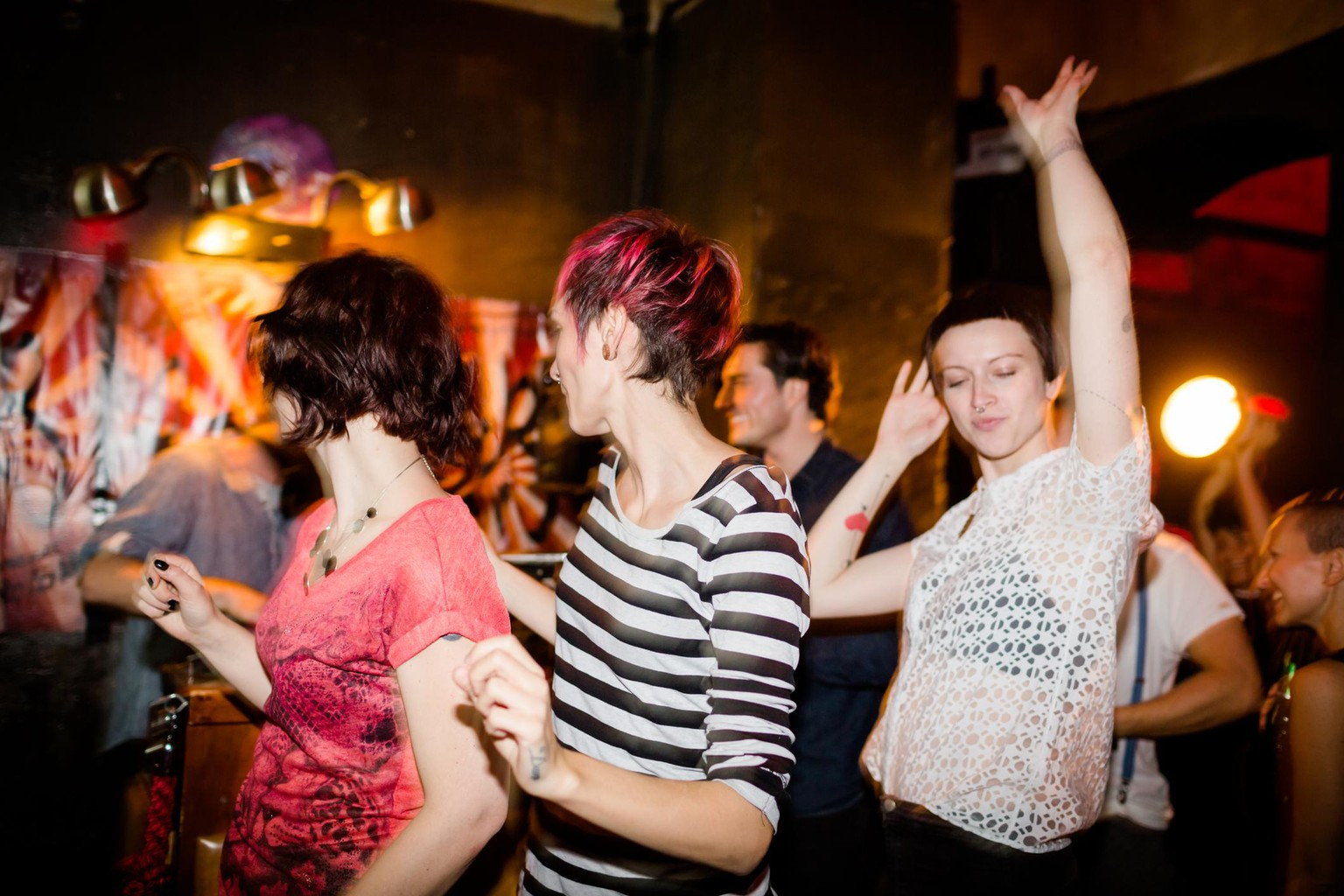 Young hip people dancing on a Berlin party.