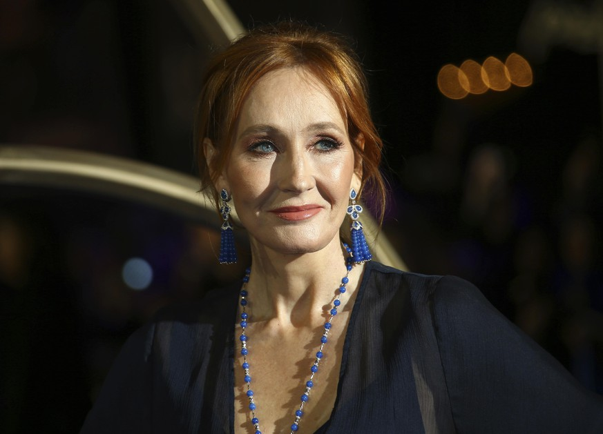 FILE - This Nov. 13, 2018 file photo shows author J.K. Rowling poses for photographers upon arrival at the premiere of the film 'Fantastic Beasts: The Crimes of Grindelwald', in London. Rowling has made a substantial donation for research into the treatment of multiple sclerosis at a center named after her late mother. The 15.3 million-pound ($18.8 million) donation announced Thursday, Sept. 12, 2019, will be used for new facilities at a research center based at the University of Edinburgh in Scotland. The author's mother suffered from the disease and died at the age of 45. (Photo by Joel C Ryan/Invision/AP, File) |