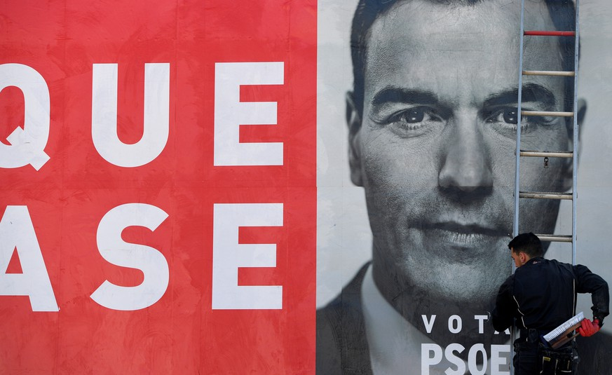 A worker places an electoral poster of Spain's Socialist leader and current Prime Minister Pedro Sanchez in La Fresneda, Spain April 12, 2019. REUTERS/Eloy Alonso