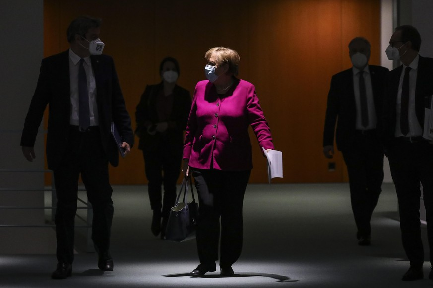 BERLIN, GERMANY - MARCH 03: German Chancellor Angela Merkel (C), Bavarian Premier Markus Soeder (L) and Berlin Mayor Michael Mueller (R) arrive to a press conference after a virtual meeting between Merkel and the leaders of Germany's 16 states during the coronavirus pandemic on March 3, 2021 in Berlin, Germany. The group agreed that Germany's current lockdown will extend to March 28 but that small steps toward easing certain elements of the lockdown may begin sooner. Germany is proceeding cautiously as COVID infection rates that were falling since December have in recent weeks begin to slowly climb, which the government attributes to the spread of the B117 variant. (Photo by Omer Messinger/Getty Images)