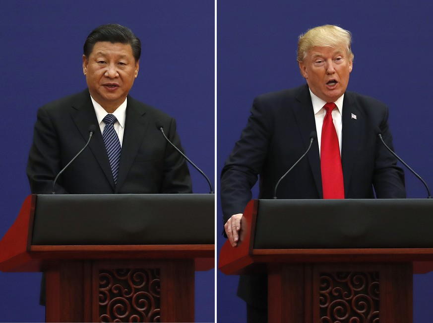 In this combination of Nov. 9, 2017 photos, U.S. President Donald Trump, right, and Chinese President Xi Jinping speak during a business event at the Great Hall of the People in Beijing. The brewing China-U.S. trade conflict features two leaders who?ve expressed friendship but are equally determined to pursue their nation's interests and their own political agendas. But while Trump faces continuing churn in his administration and a tough challenge in midterm congressional elections, Xi leads an outwardly stable authoritarian regime. Xi recently succeeded in pushing through a constitutional reform allowing him to rule for as long as he wishes while facing no serious electoral challenge. (AP Photo/Andy Wong) |