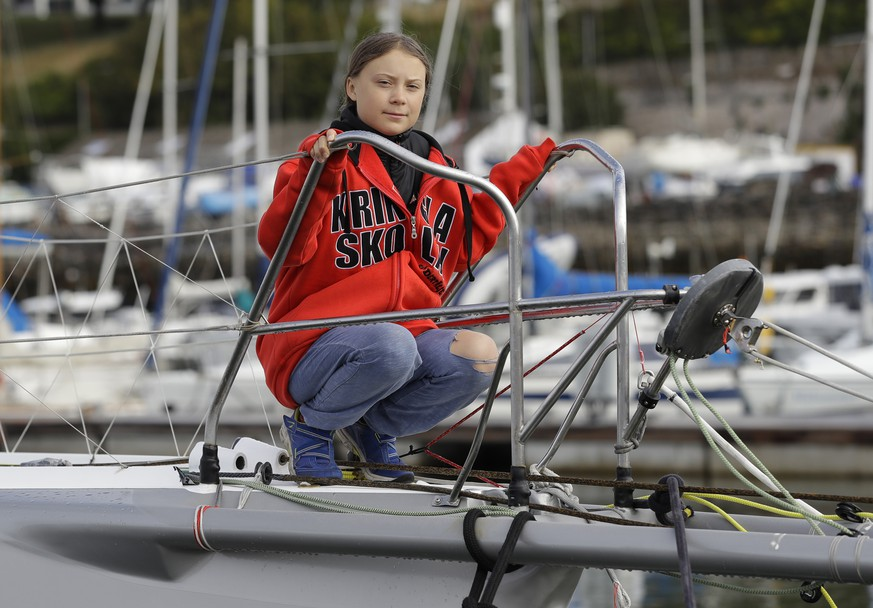Greta Thunberg poses for a picture on the boat Malizia as it is moored in Plymouth, England Tuesday, Aug. 13, 2019. Greta Thunberg, the 16-year-old climate change activist who has inspired student protests around the world, is heading to the United States this week - in a sailboat. (AP Photo/Kirsty Wigglesworth)