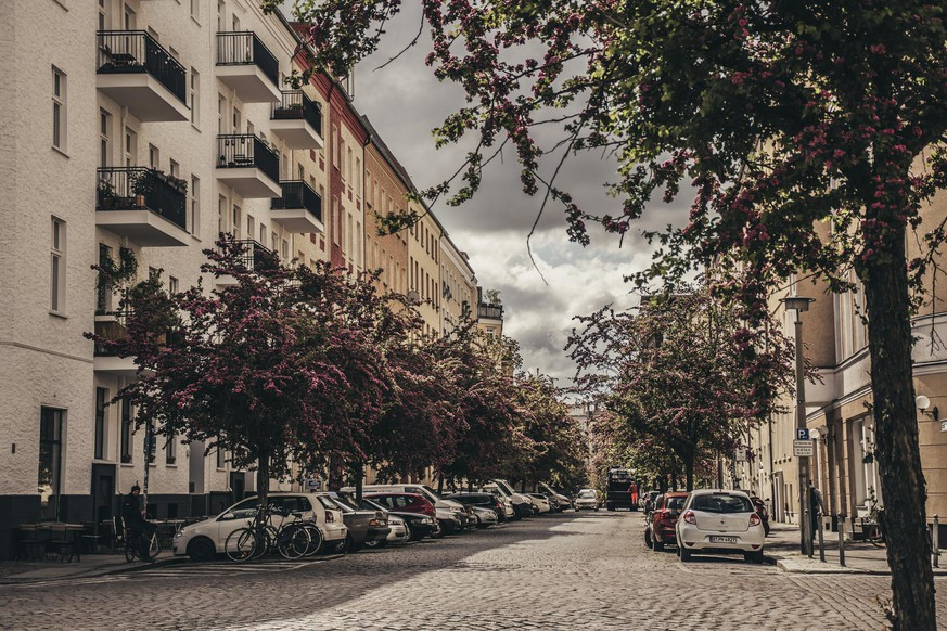 14 May 2019, berlin, Germany - residential district in Berlin. Blooming trees in morning