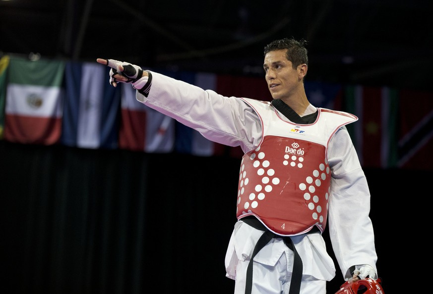 FILE - In this July 21, 2015 file photo, United States' Steven Lopez celebrates winning a bronze medal by defeating Venezuela's Javier Medina in the men's taekwondo under-80kg category at the Pan Am Games in Mississauga, Ontario. The U.S. Center for SafeSport has on Thursday, Sept. 6, 2018, permanently banned the two-time Olympic taekwondo champion for sexual misconduct involving a minor. (AP Photo/Rebecca Blackwell, File)