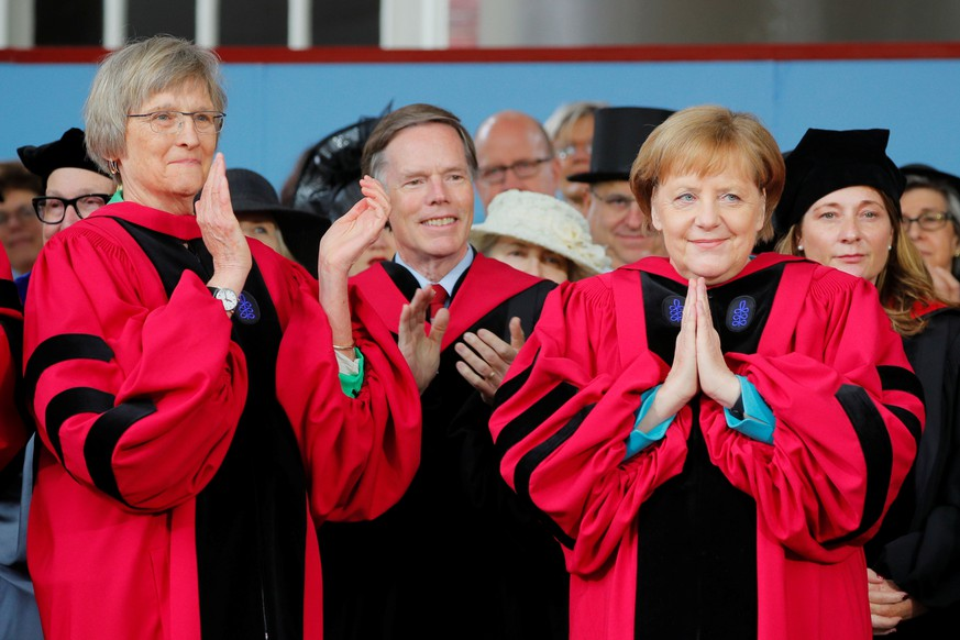 German Chancellor Angela Merkel acknowledges the applause, including from fellow honorary degree recipient Drew Faust (L), as Merkel receives an honorary Doctor of Laws degree during the 368th Commencement Exercises at Harvard University in Cambridge, Massachusetts, U.S., May 30, 2019.   REUTERS/Brian Snyder