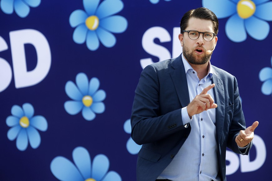 FILE - In this Aug. 17, 2018 file photo the leader of the Sweden Democrats, Jimmie Akesson campaigns in Sundsvall, Sweden, ahead of the upcoming Swedish general election. Sweden will go to the polls on Sept. 9. (Mats Andersson / TT via AP, file)