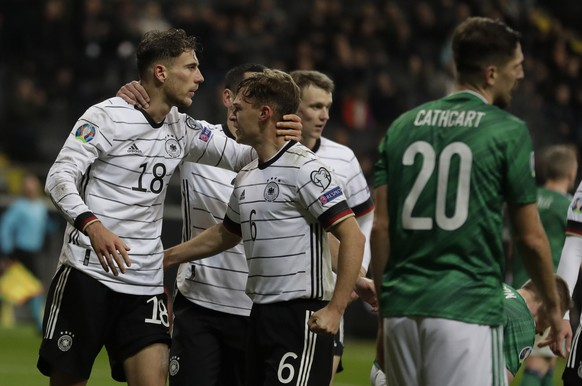Germany's Leon Goretzka, left, with his teammate Joshua Kimmich, celebrates his goal against Northern Ireland during a Group C soccer qualifying match between Germany and Northern Ireland at the Commerzbank Arena in Frankfurt, Germany, Tuesday, Nov. 19, 2019. (AP Photo/Michael Probst)