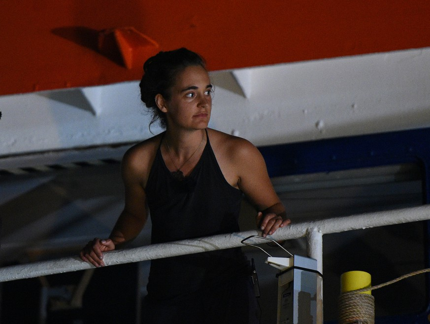 Carola Rackete, the 31-year-old Sea-Watch 3 captain, is seen onboard the ship as it docks in Lampedusa, Italy June 29, 2019. REUTERS/Guglielmo Mangiapane