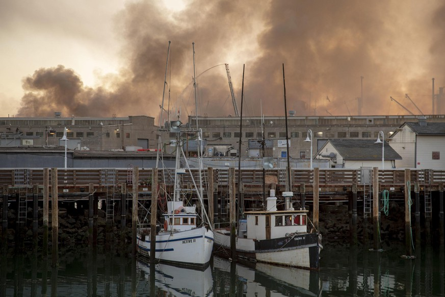 The Liberty ship SS Jeremiah O'Brien appears through the clearing smoke of a four-alarm fire burning on Pier 45 in San Francisco on Saturday, May 23, 2020. (Karl Mondon/Bay Area News Group/TNS) Photo via Newscom picture alliance |