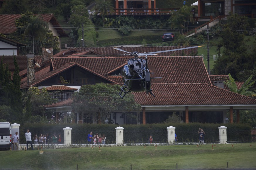 A helicopter transporting Brazil's soccer player Neymar arrives to the Granja Comary training center, ahead of the Copa America tournament, in Teresopolis, Saturday, May 25, 2019. (AP Photo/Silvia Izquierdo)