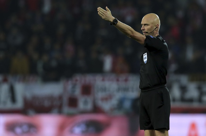Referee Sergei Karasev gestures during the UEFA Nations League soccer match between Portugal and Poland at the D. Afonso Henriques stadium in Guimaraes, Portugal, Tuesday, Nov. 20, 2018. (AP Photo/Manuel Araujo)