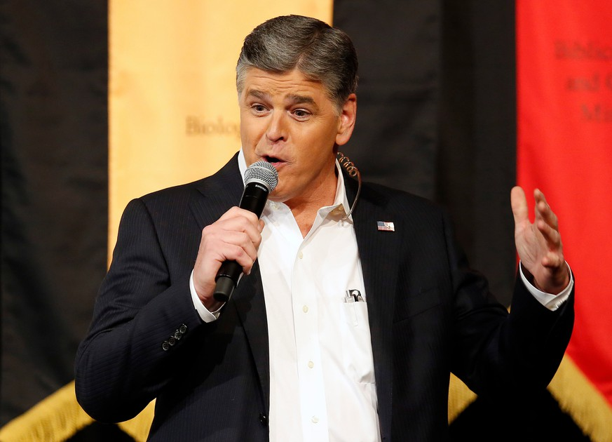 FILE - In this March 18, 2016 file photo, Fox News Channel's Sean Hannity speaks during a campaign rally for Republican presidential candidate, Sen. Ted Cruz, R-Texas, in Phoenix.  The Fox News Channel host  is vowing to continue his attacks on ABC late-night comic Jimmy Kimmel until Kimmel apologizes for a segment in which he joked about first lady Melania Trump's accent. The dispute between the television personalities is unusually vitriolic, with Hannity calling Kimmel a