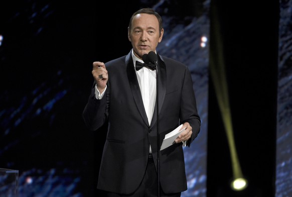 FILE - In this Oct. 27, 2017, file photo, Kevin Spacey presents an award in Beverly Hills, Calif. A Massachusetts prosecutor says Spacey is scheduled to be arraigned Jan. 7, 2019, on a charge of indecent assault and battery for allegedly sexually assaulting the teenage son of a Boston television anchor in a Nantucket restaurant. (Photo by Chris Pizzello/Invision/AP, File)