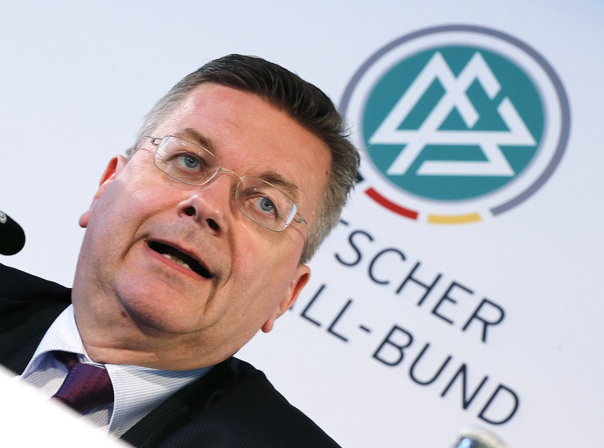 FILE---President of German football federation, DFB, Reinhard Grindel speaks during a finance press conference of the DFB in Frankfurt, Germany, Thursday, June 2, 2016. (AP Photo/Michael Probst)