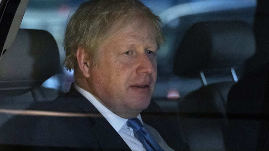 British Prime Minister Boris Johnson leaves his hotel, Tuesday, Sept. 24, 2019, in New York. (AP Photo/Mark Lennihan)