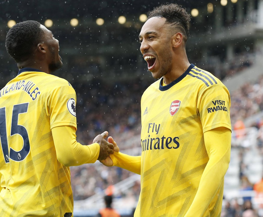 Football - 2019 / 2020 Premier League - Newcastle United vs. Arsenal Pierre-Emerick Aubameyang of Arsenal celebrates his goal, at St James Park. COLORSPORT/BRUCE WHITE PUBLICATIONxNOTxINxUK