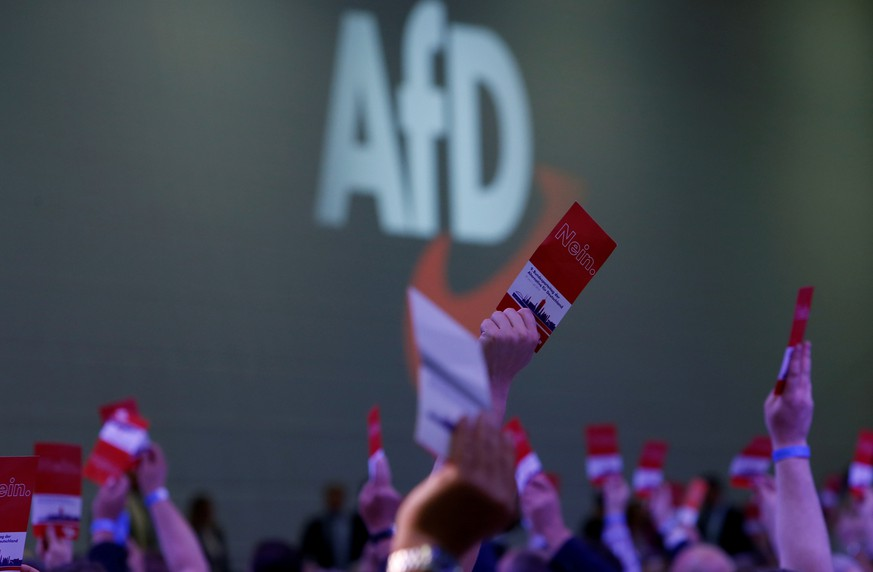 FILE PHOTO: Participants vote during the Alternative for Germany (AfD) two-day party congress in Augsburg, Germany, June 30, 2018.  REUTERS/Michaela Rehle/File Photo