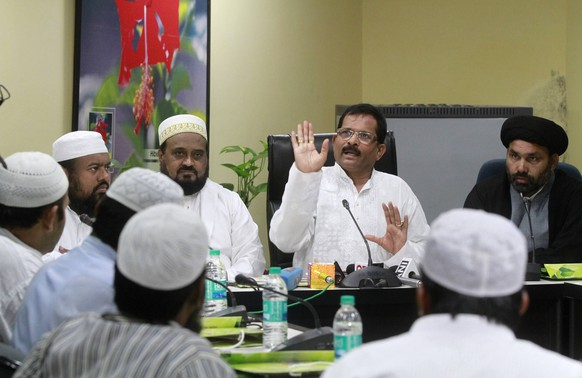 NEW DELHI, INDIA - JUNE 11: A delegation of minority leaders meeting with Minister of State for AYUSH and Health & Family Welfare, Shripad Yesso Naik, to convey their support for International Day of Yoga on June 11, 2015 in New Delhi, India. The Muslim leaders, who included Majlis Ulema e Hind (Uttar Pradesh) president Maulana Syed Kaukab Mujtaba Abidi, Maulana Suhaib Qasmi, and Daudi Bohra community representative Abbas Ali Bohra, on their part applauded the initiative of Prime Minister Narendra Modi for the Yoga Day. Dubbing the Yoga Day celebrations as Hindu religious practices , the All India Muslim Personal Law Board had said it was planning nationwide agitations. (Photo by Sanjeev Verma/Hindustan Times ) Muslim Delegation Meets AYUSH Minister, Lend Support For Yoga Day PUBLICATIONxNOTxINxINDNew Delhi India June 11 a Delegation of Minority Leaders Meeting With Ministers of State for Ayush and Health & Family Welfare   Naik to convey their Support for International Day of Yoga ON June 11 2015 in New Delhi India The Muslim Leaders Who Included Majlis Ulema e Hind Uttar Pradesh President Maulana Syed  Mujtaba Abidi Maulana Suhaib  and Daudi Bohra Community Representative Abbas Ali Bohra ON their Part applauded The Initiative of Prime Ministers Narendra Modes for The Yoga Day Dubbing The Yoga Day celebrations As Hindu Religious Practices The All India Muslim Staff Law Board had Said IT what Planning nation agitations Photo by Sanjeev Verma Hindustan Times Muslim Delegation Meets Ayush Ministers Lend Support for Yoga Day PUBLICATIONxNOTxINxIND