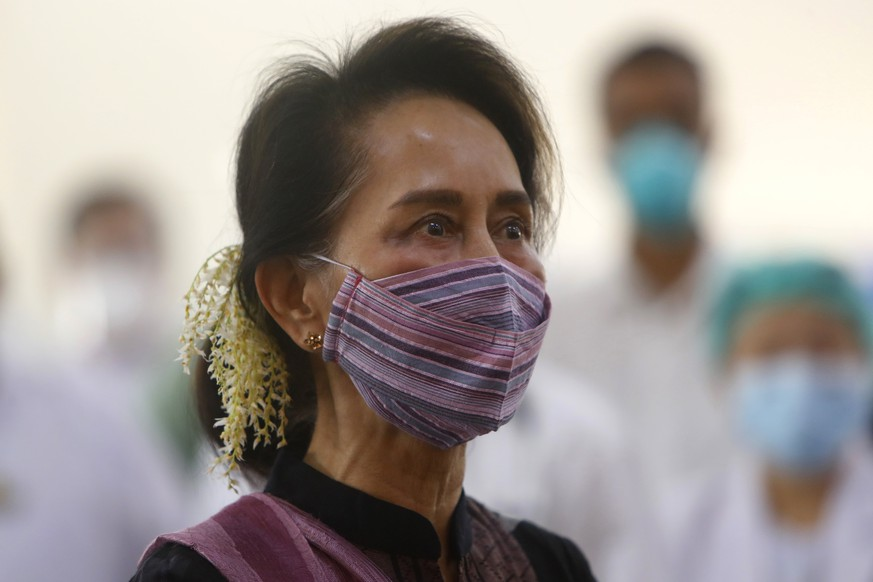 FILE - In this Jan 27, 2021, file photo, Myanmar leader Aung San Suu Kyi watches the vaccination of health workers at hospital in Naypyitaw, Myanmar. Reports says Monday, Feb. 1, 2021 a military coup has taken place in Myanmar and Suu Kyi has been detained under house arrest. (AP Photo/Aung Shine Oo, File)