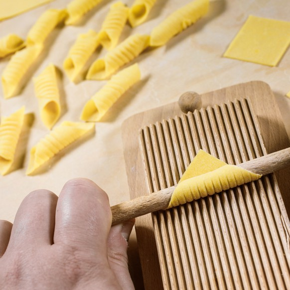 Garganelli, a kind of special homemade macaroni, at the end of preparation process.