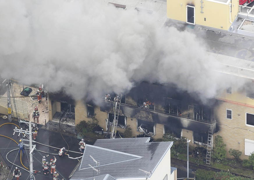 An aerial photo shows the fire site burning with fire in Kyoto on July 18, 2019. On the morning of 18th, a fire occurred with an explosion sound at a studio of an animation production company